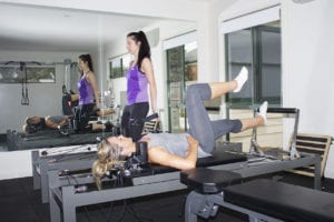 Two women shown doing pilates at Healthy Bodies Physiotherapy's centre in Cheltenham, Victoria