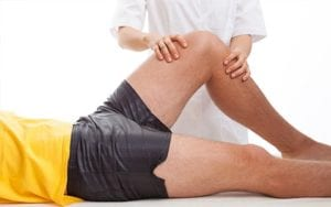 A healthy bodies physiotherapy's therapist massaging and relieving knee pain of a client