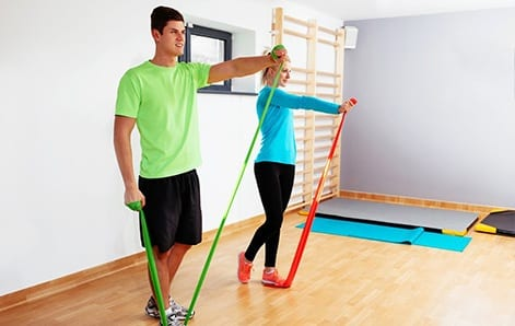 A man and a woman shown stretching their arms in healthy bodies physiotherapy's centre