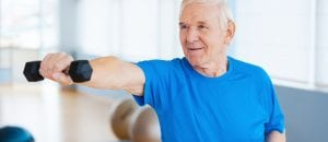 An older man holding a dumbbell